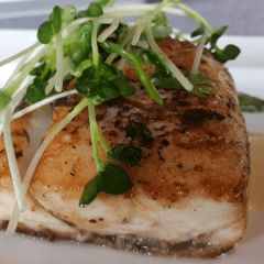 lightly fried fish with watercress